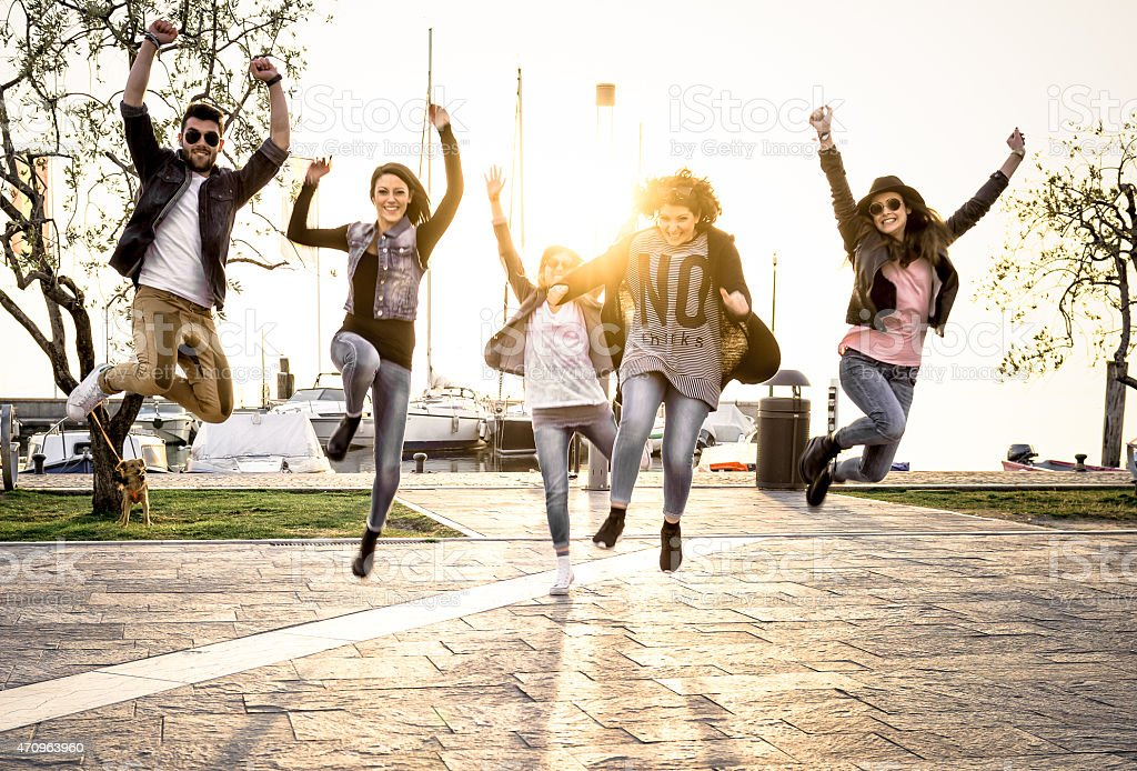 group of people jumping stock photo