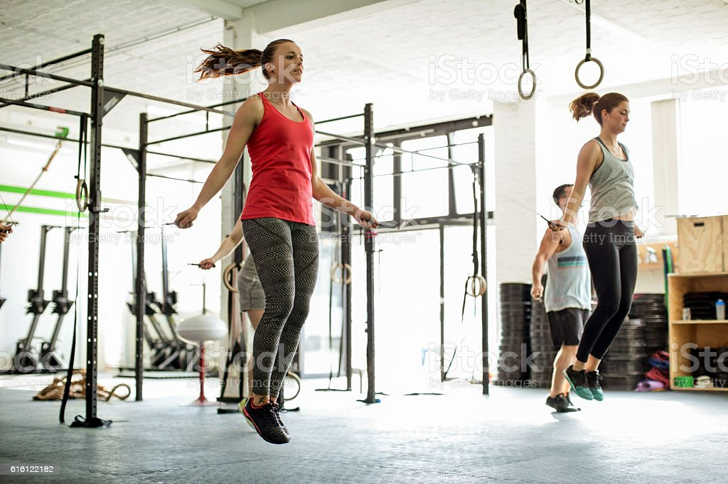 Group of people jumping rope in a fitness class stock photo
