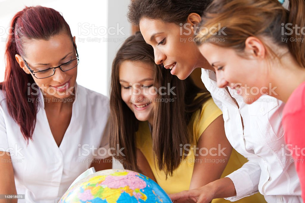 Group Of People Looking At Globe royalty-free stock photo