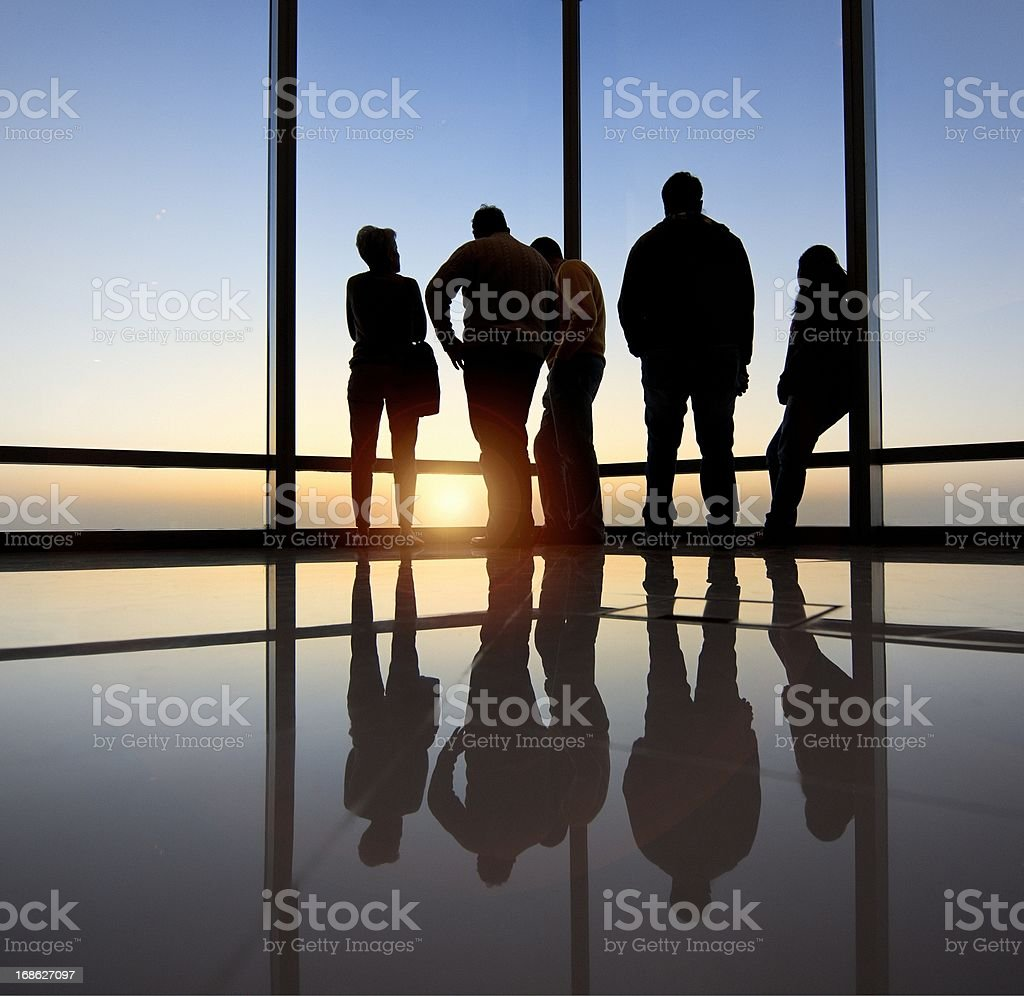 Group of people looking at sunrise royalty-free stock photo
