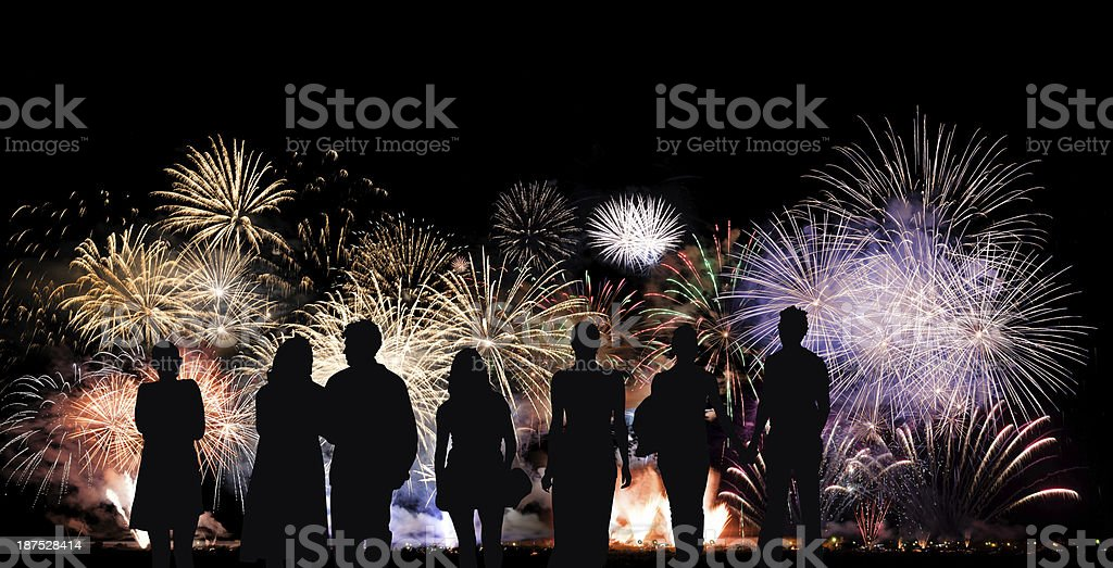 Group of people looks beautiful colorful holiday fireworks stock photo