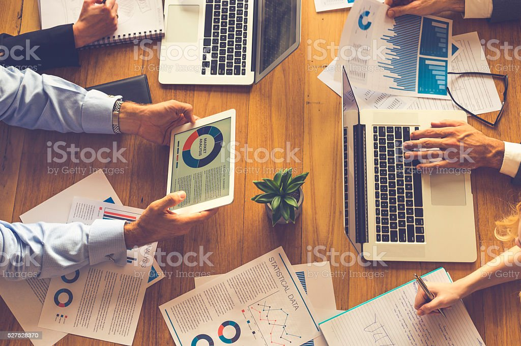 Group of people meeting with technology. stock photo