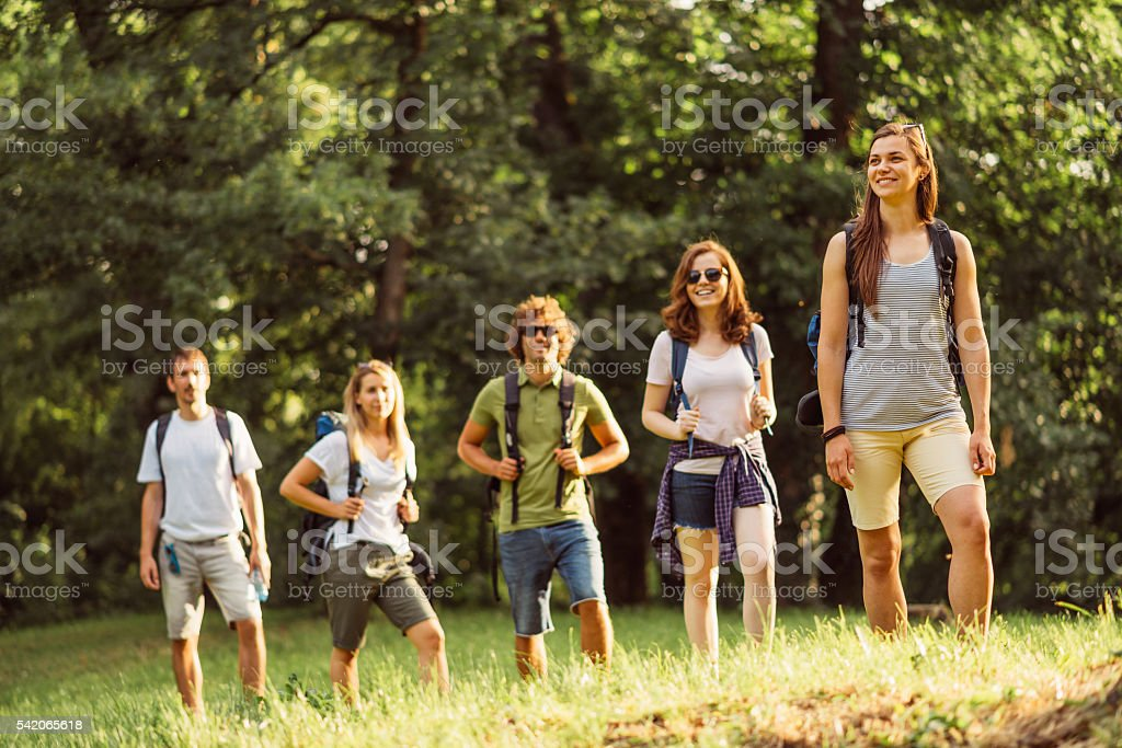 Group of people mountaineering and camping in woods stock photo