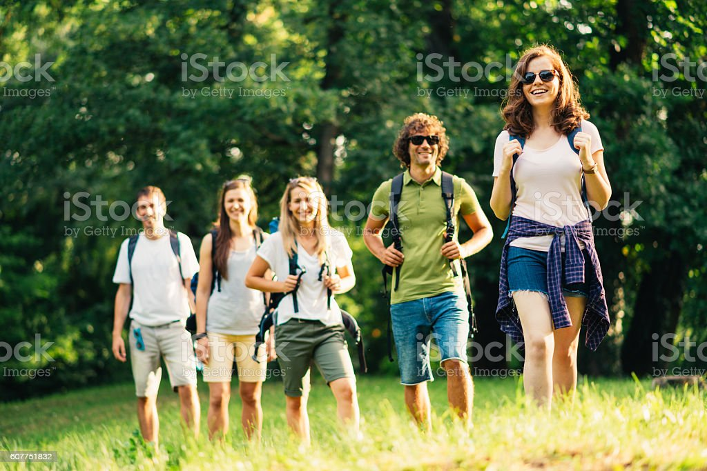 Group of people mountaineering and orienteering in woods stock photo