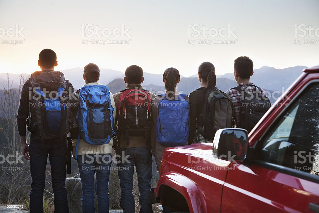 Group of people next to car and looking at mountains royalty-free stock photo