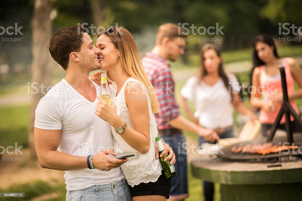 Group of people on a barbecue picnic stock photo