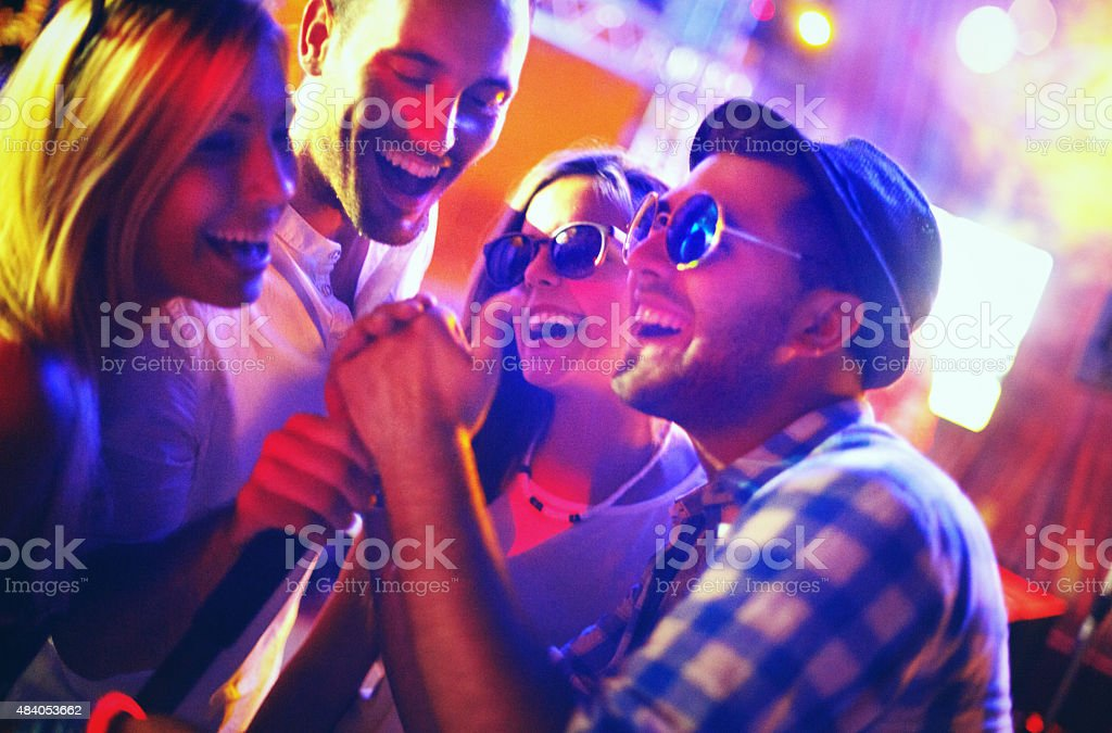 Group of people on a karaoke contest. stock photo