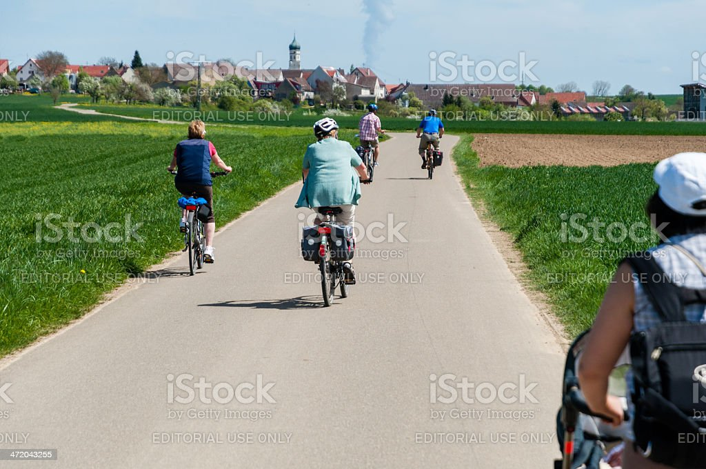 Group of people on bicycle tour in rural landscape. Germany stock photo