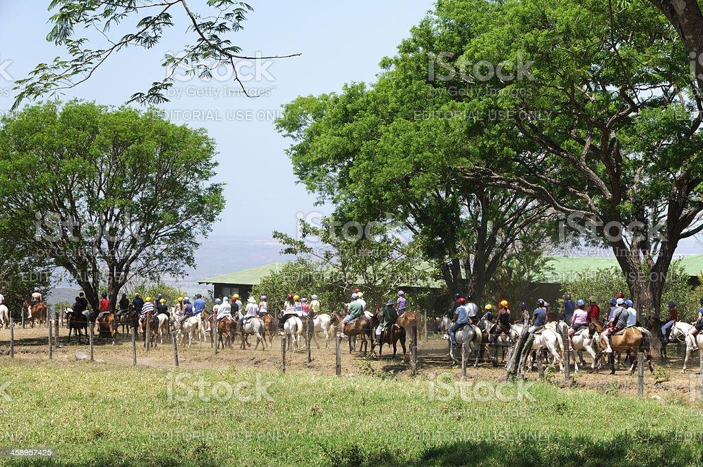 Group of people on horseback tour royalty-free stock photo