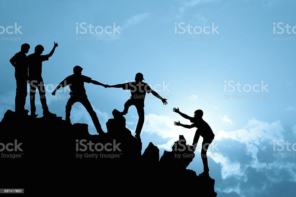 Group of people on peak mountain stock photo