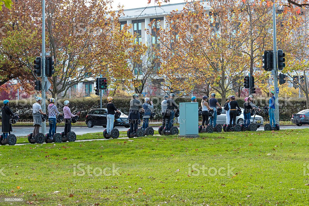 Group of people on Segway city tour in Canberra, Australia stock photo