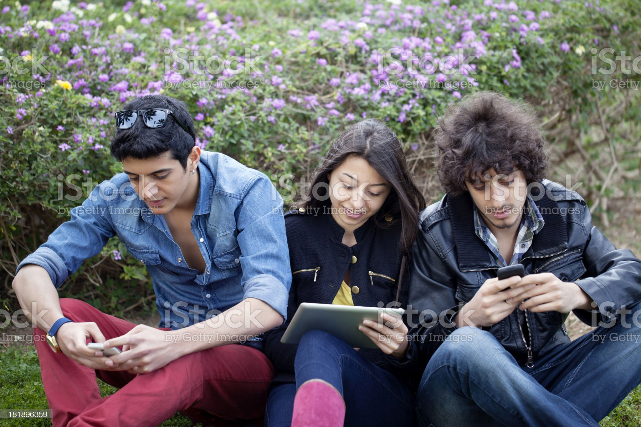 Group of people outside with tablet and cellphones royalty-free stock photo