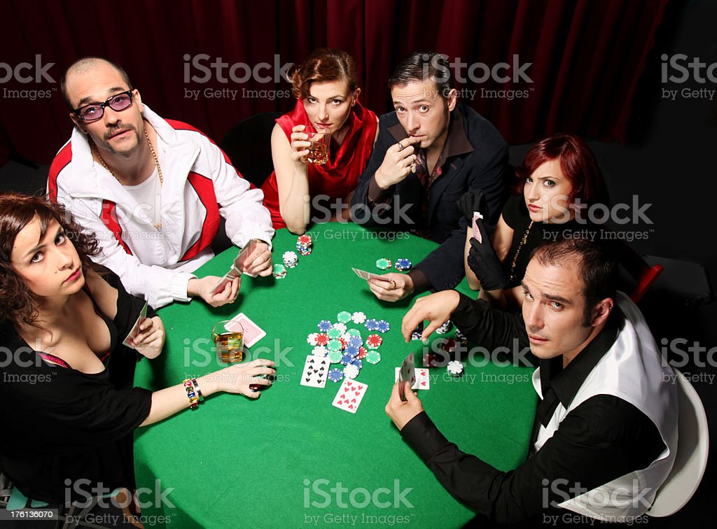 Group of people playing cards, poker royalty-free stock photo