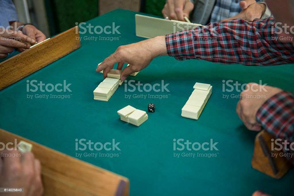 Group of people playing okey stock photo