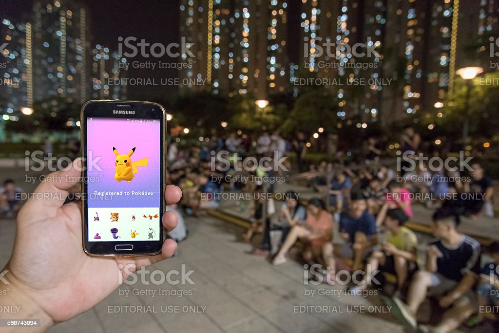 Group of people playing Pokemon go stock photo