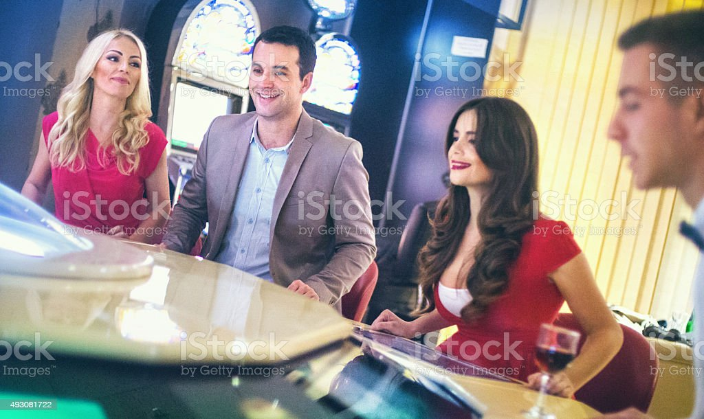 Group of people playing roulette. stock photo