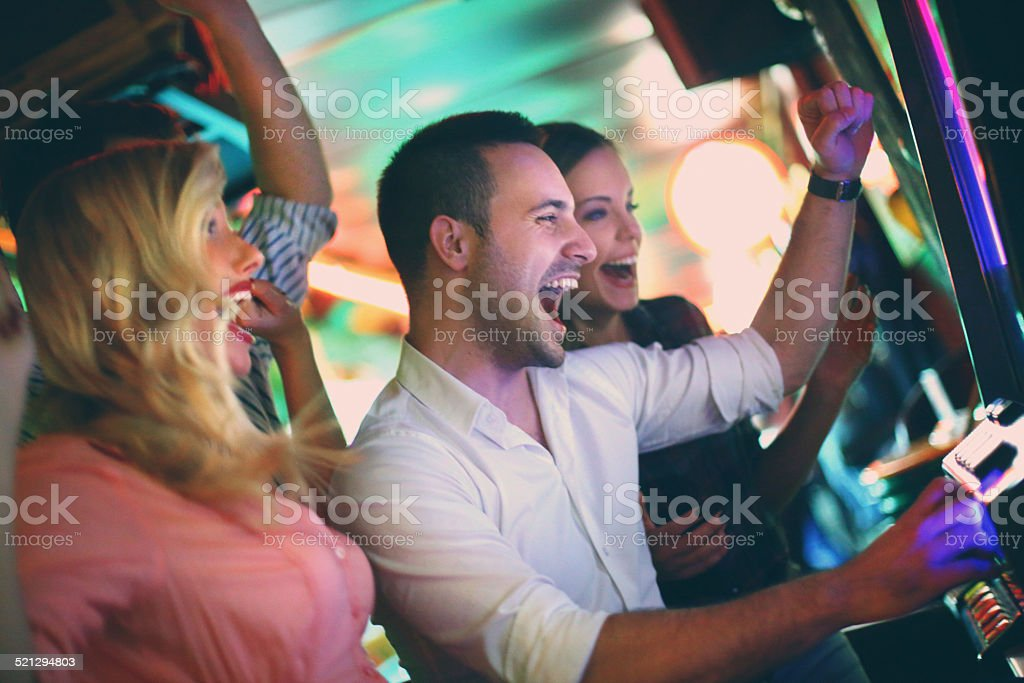 Group of people playing slots. stock photo