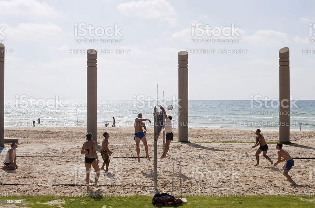 Group of people playing volleyball on the beach . royalty-free stock photo
