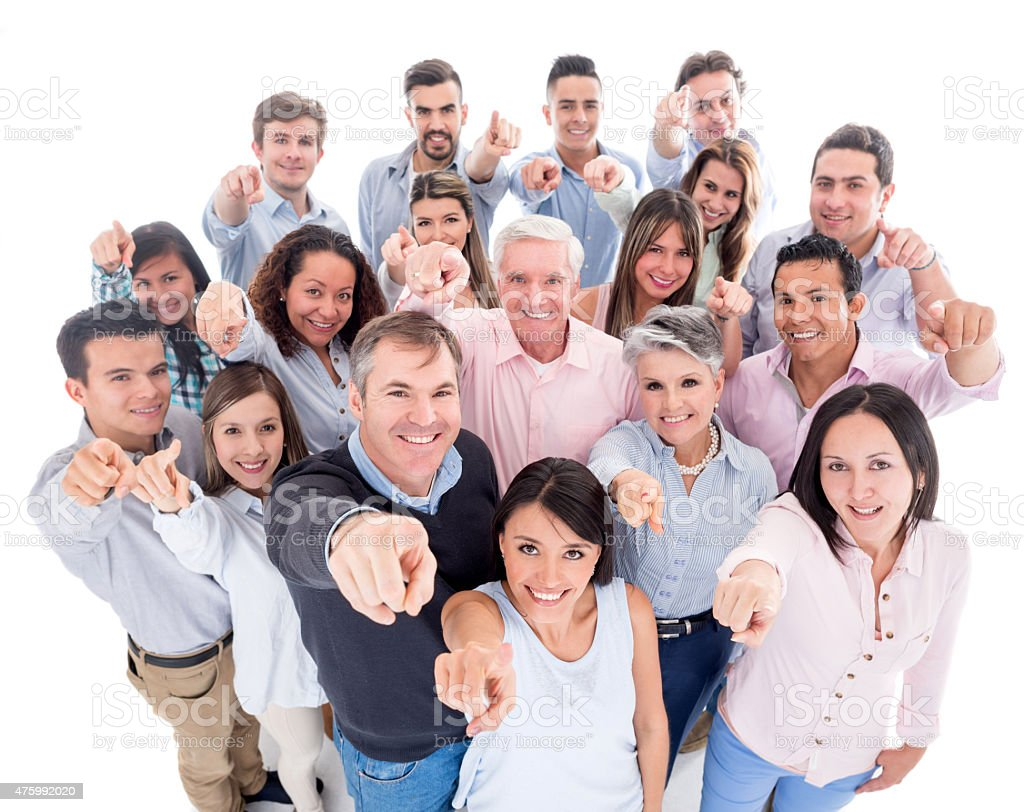 Group of people pointing at the camera stock photo