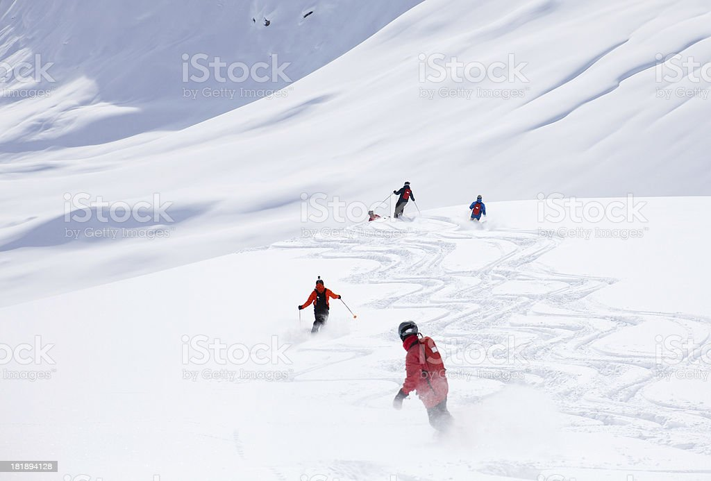 Group of People Powder Skiing royalty-free stock photo