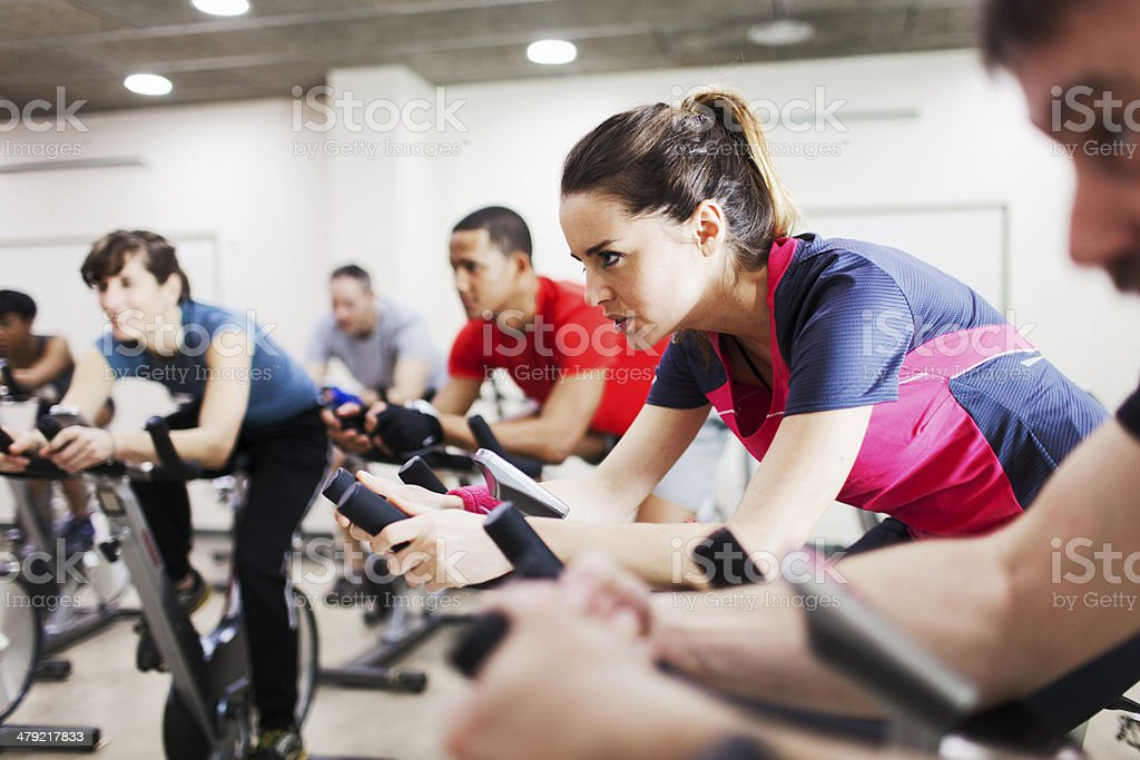 Group of people practicing sport in a gym. stock photo