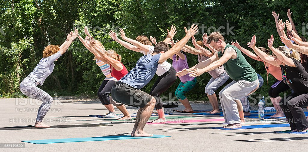 Group of people practicing yoga in nature stock photo