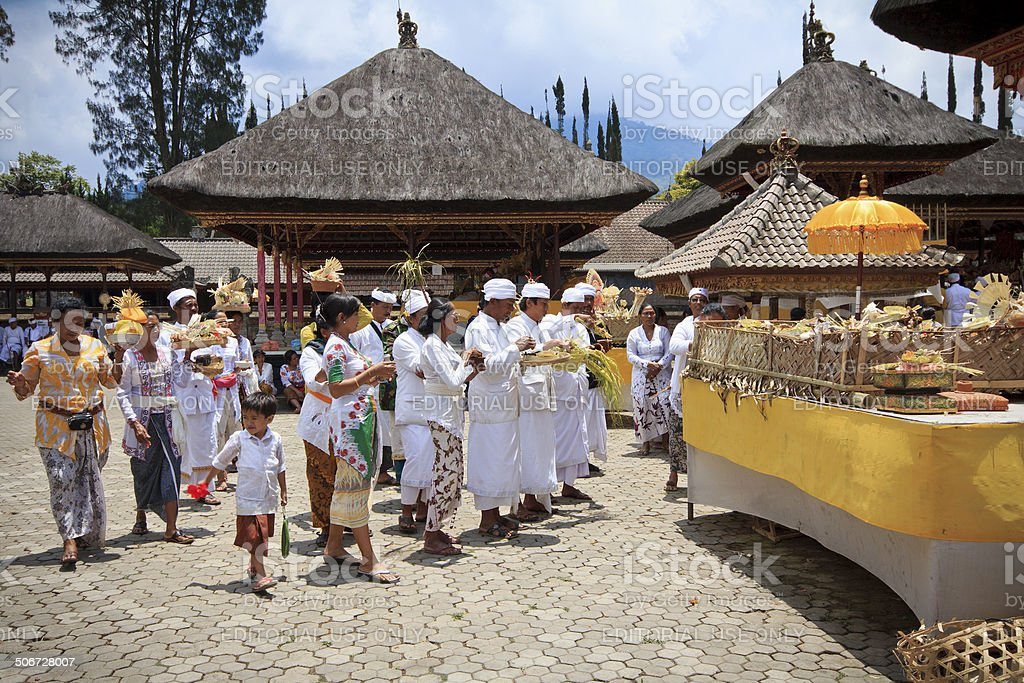 Group of people praying at Pura Ulun Danu Batur temple royalty-free stock photo