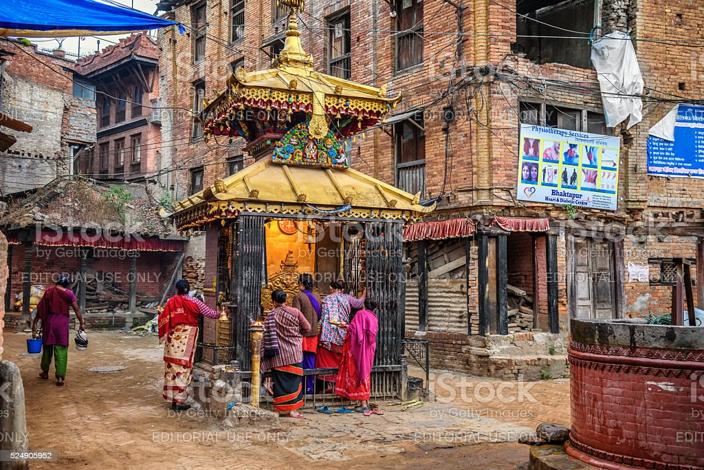 Group of people  praying in the street of Kathmandu, Nepal stock photo