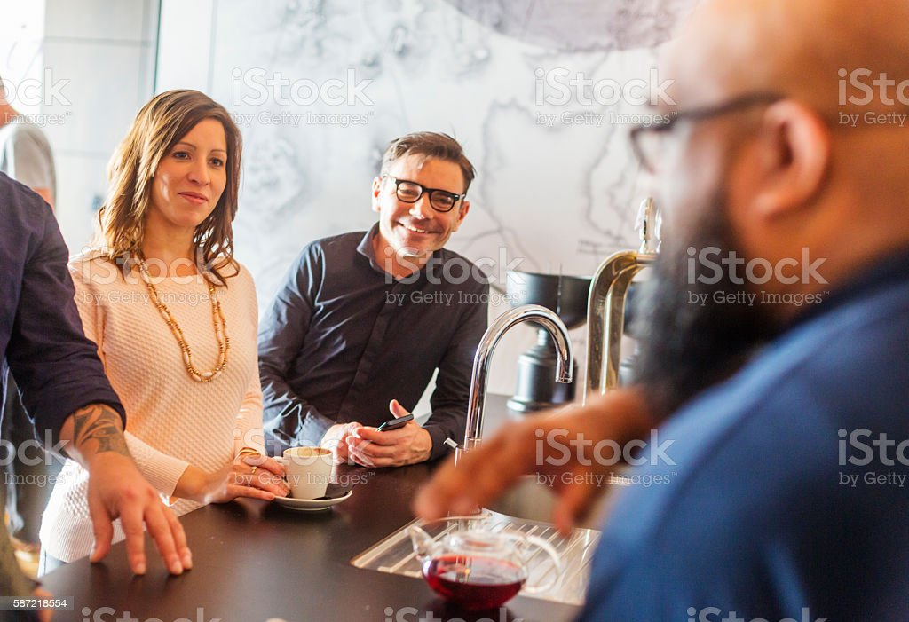 Group of People Relaxing in a Bar after Work stock photo