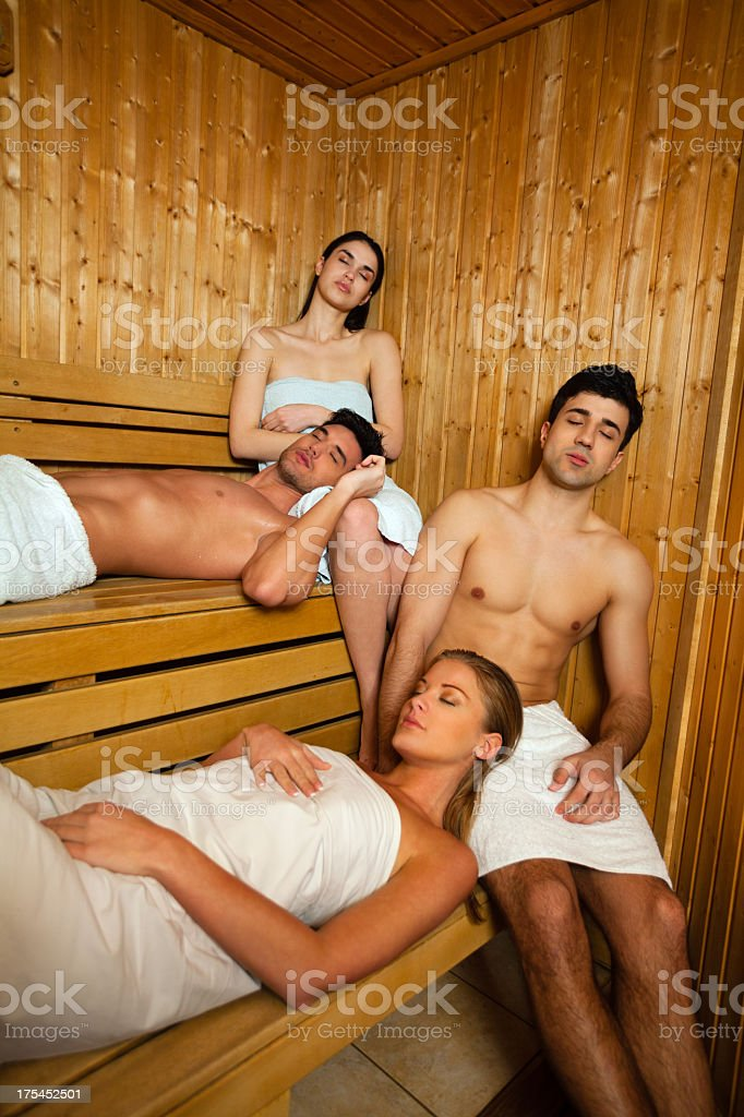 Group of people relaxing in sauna stock photo