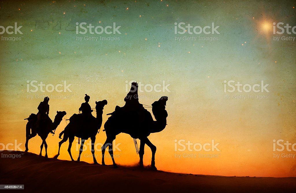 Group of People Riding Camel Isolated on Background stock photo