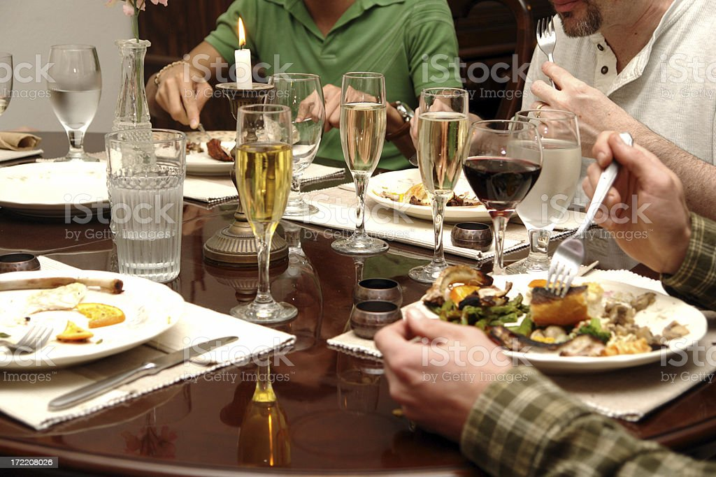 Group of people sat at a table eating a meal royalty-free stock photo