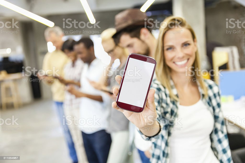 Group of people showing their smart phones stock photo