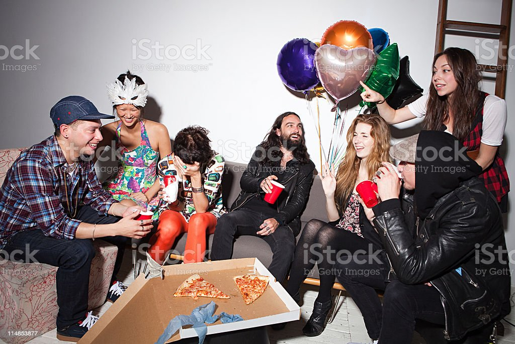 Group of people sitting at party stock photo