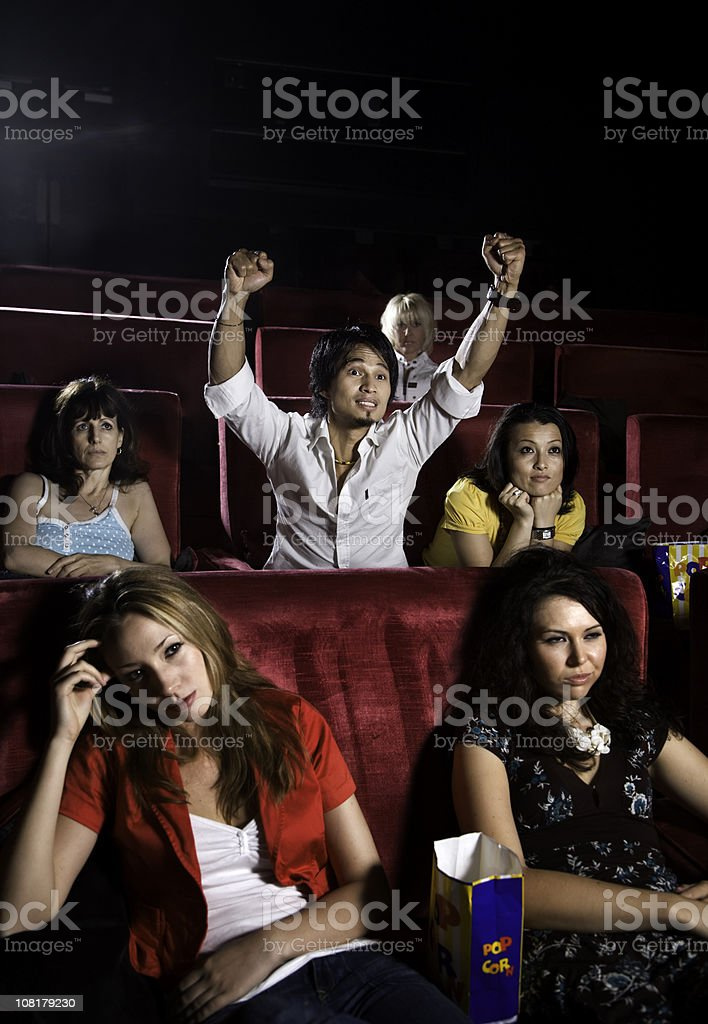 Group of People Sitting in Movie Theatre royalty-free stock photo