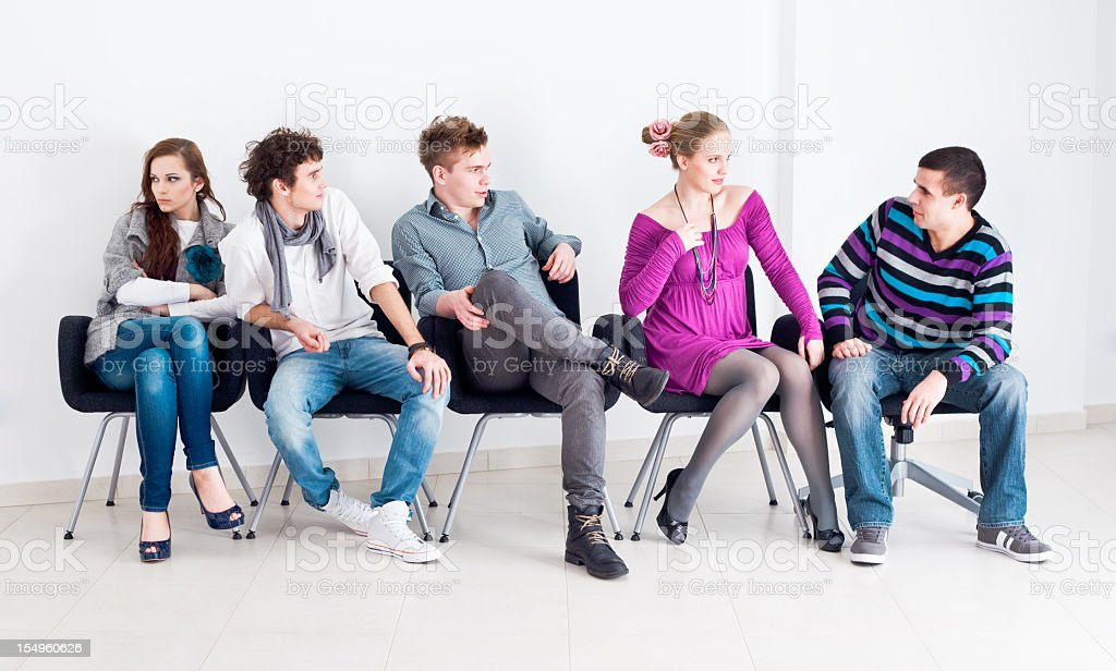 Group of people sitting stock photo
