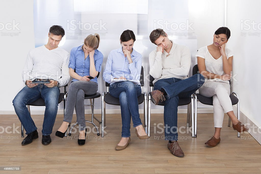Group Of People Sleeping On Chair stock photo