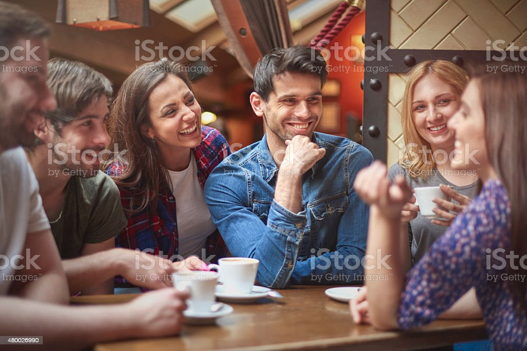Group of people spending time together stock photo