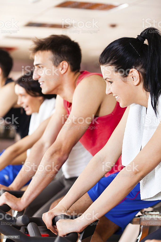 Group of people spinning in gym royalty-free stock photo