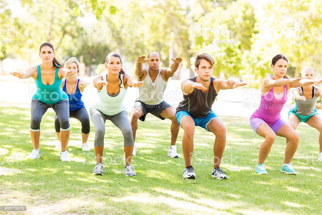 Group of People Squating In Bootcamp Class stock photo