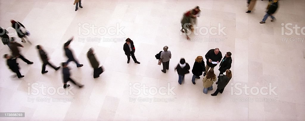 A group of people standing in a museum royalty-free stock photo