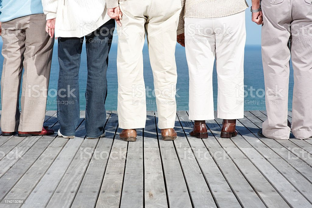 Group of people standing on wooden plank - Outdoor stock photo