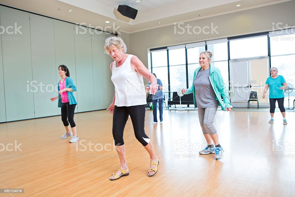 Group of people take dancing class at recreation center stock photo