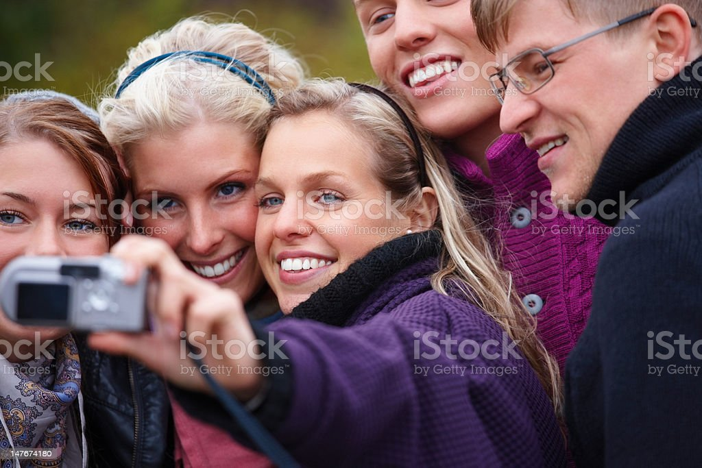 Group of people taking a picture with camera royalty-free stock photo