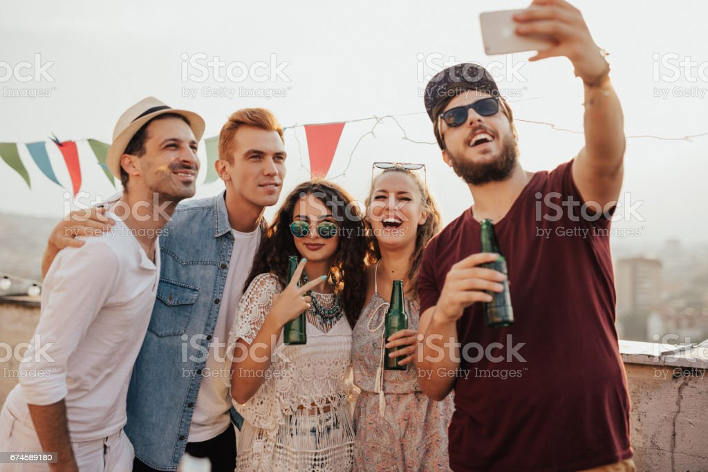 Group of people taking a selfie on the roof stock photo