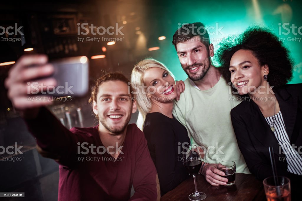 Group of people taking a selfie stock photo