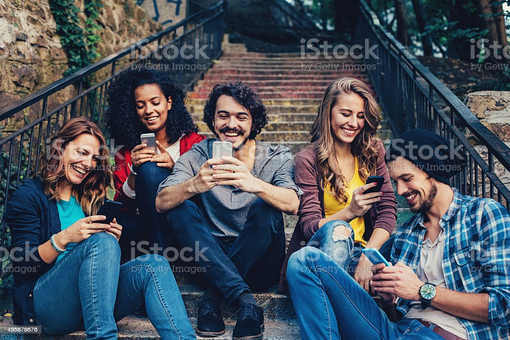 Group of people text messaging stock photo