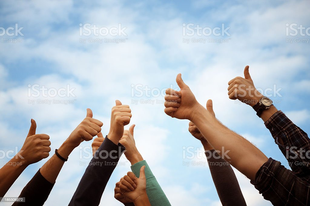 Group Of People Thumbs Up Blue Sky.Copy Space stock photo