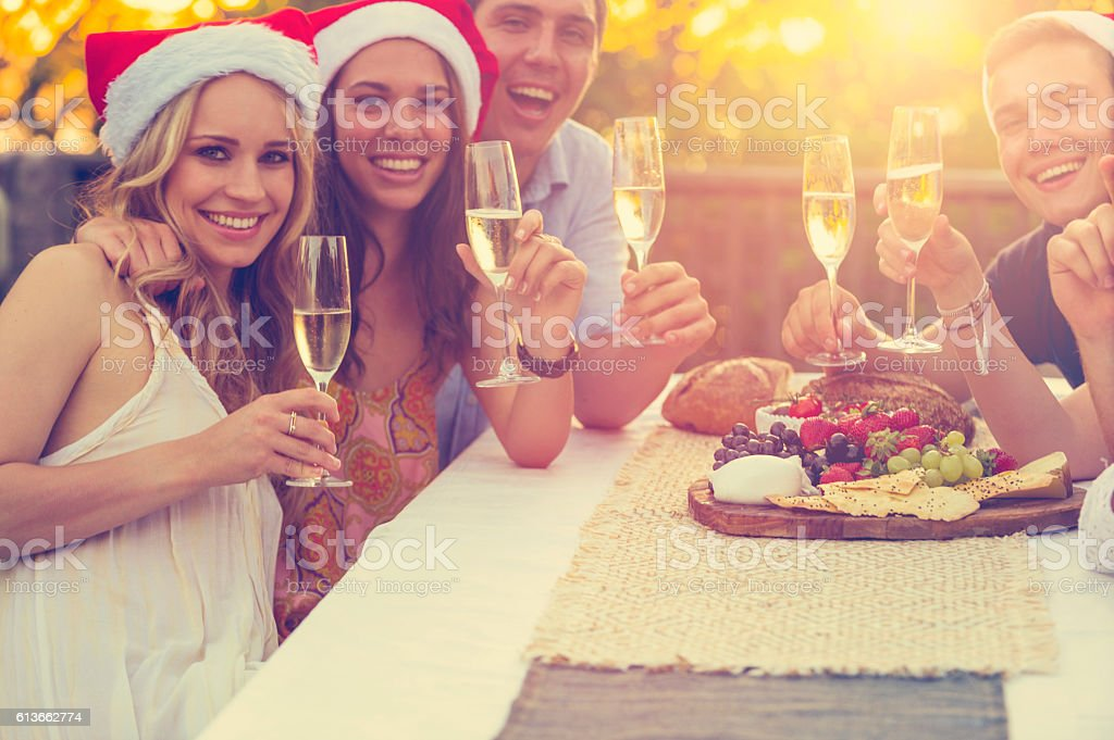 Group of people toasting with champagne stock photo