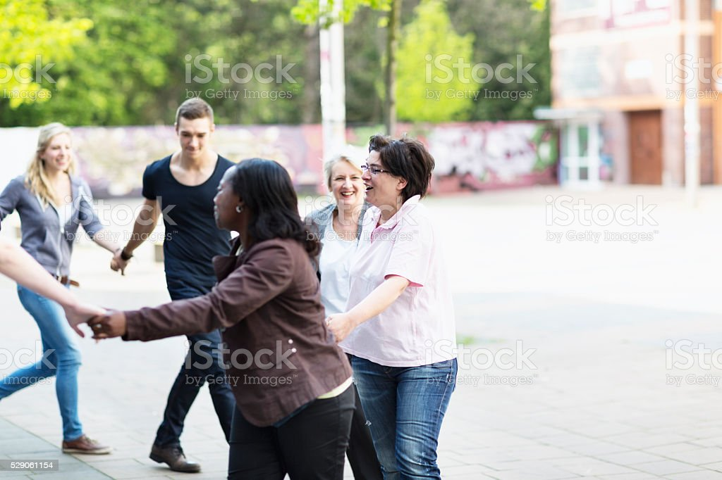 group of people togetherness in motion stock photo